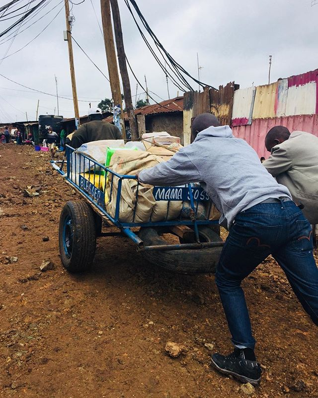 Moving supplies around Kibera is no easy task but the work is always worth it for our hungry students!