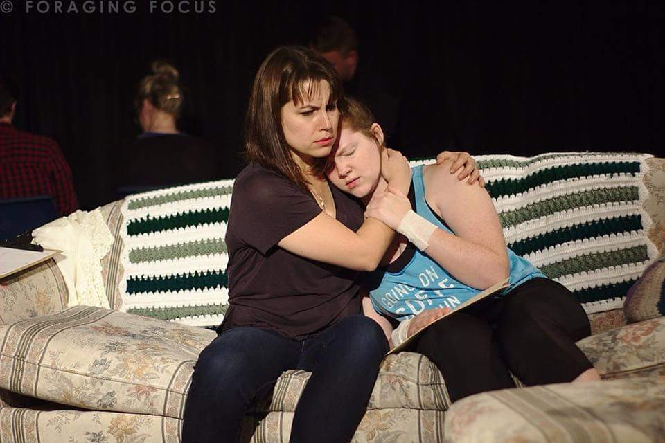 "Kyla Williger (Avery) and Elizabeth Domer (Macy) perform ""Porchlight"" in Rubber City Theatre's reading, September 2018 (Photo by Foraging Focus, 2018)"