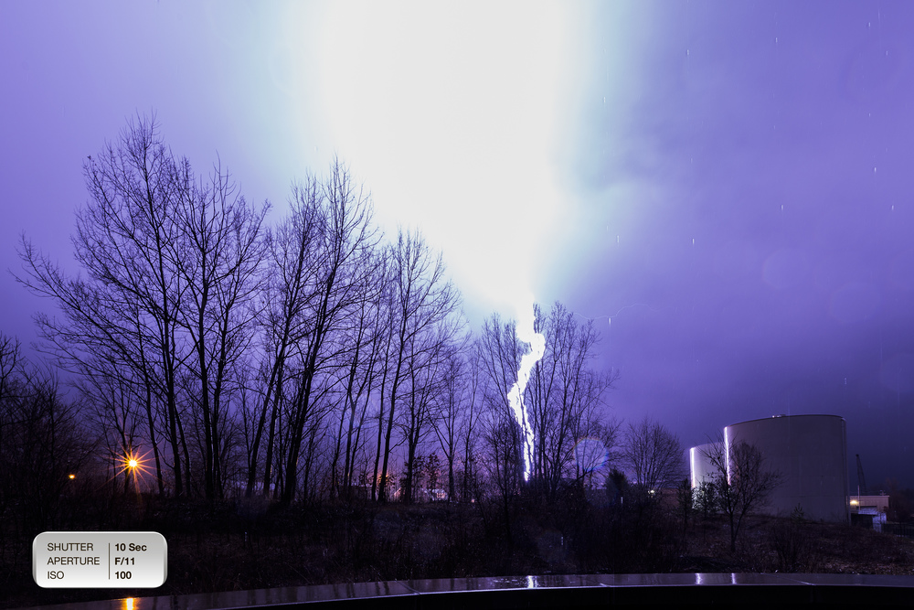 "CRACK: Lightning crashed down right near the water treatment plant in Big Rapids. After several hours of waiting, I finally ""got the shot."" I also may have ""got"" a heart attack."