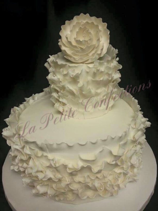 Wedding Cake with ruffles flowers- La Petite Confections.png