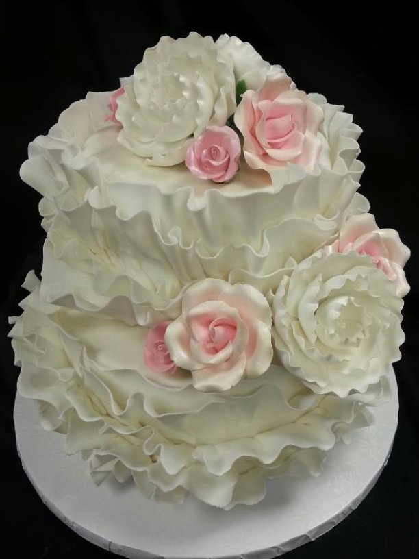 Wedding Cake with ruffles- La Petite Confections.png