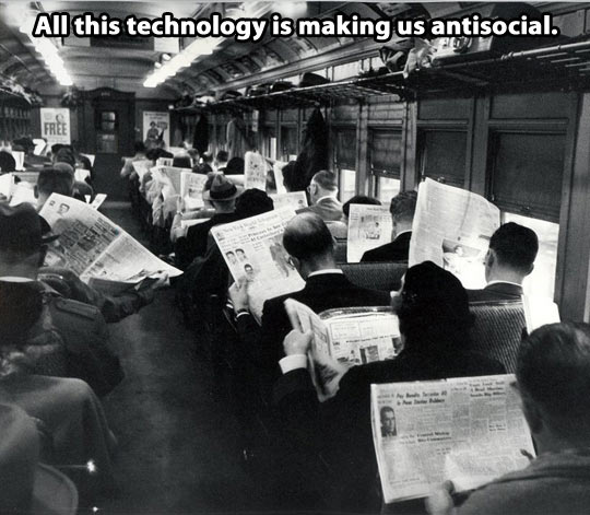 back-in-times-people-reading-newspapers-in-train