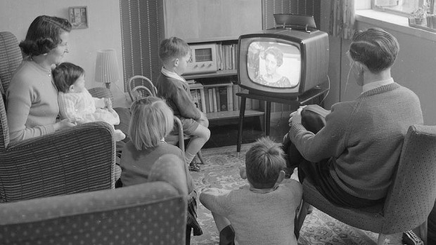 family watching tv black and white
