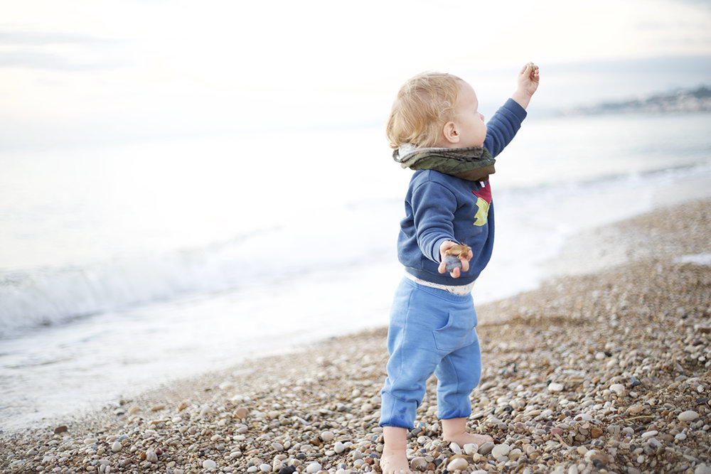 rowan daddy mamma picking stones beach.jpg