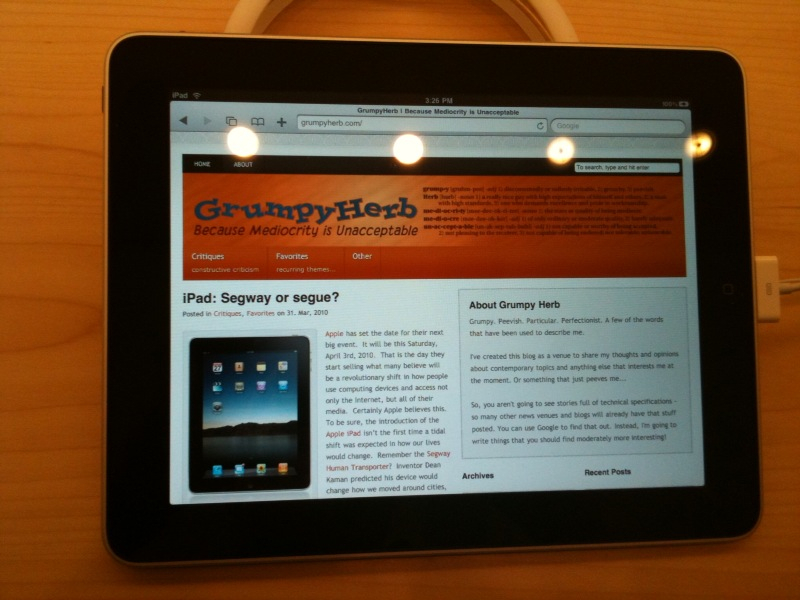 The iPad displays the home page of the GrumpyHerb blog.