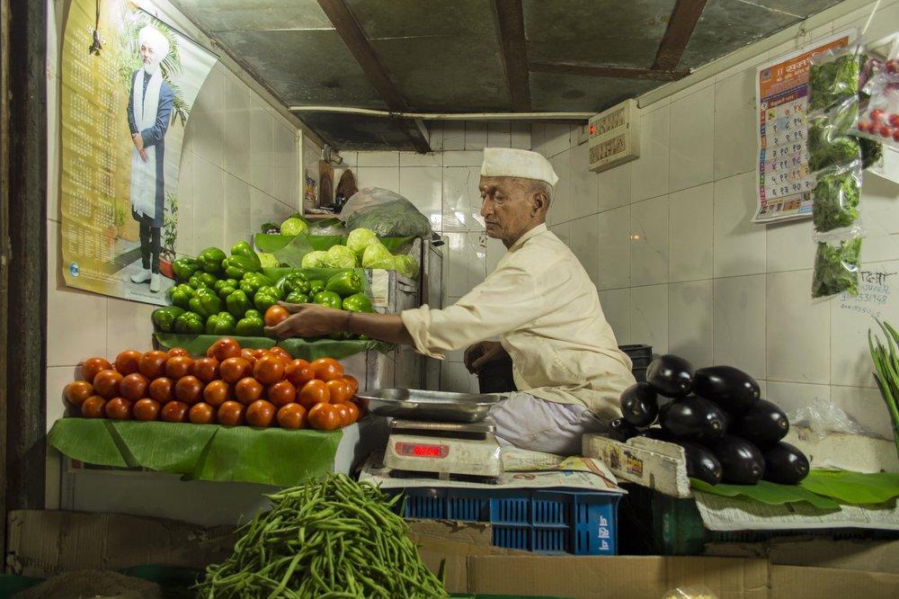 Vegetable wallah in Mumbai's Crawford Market