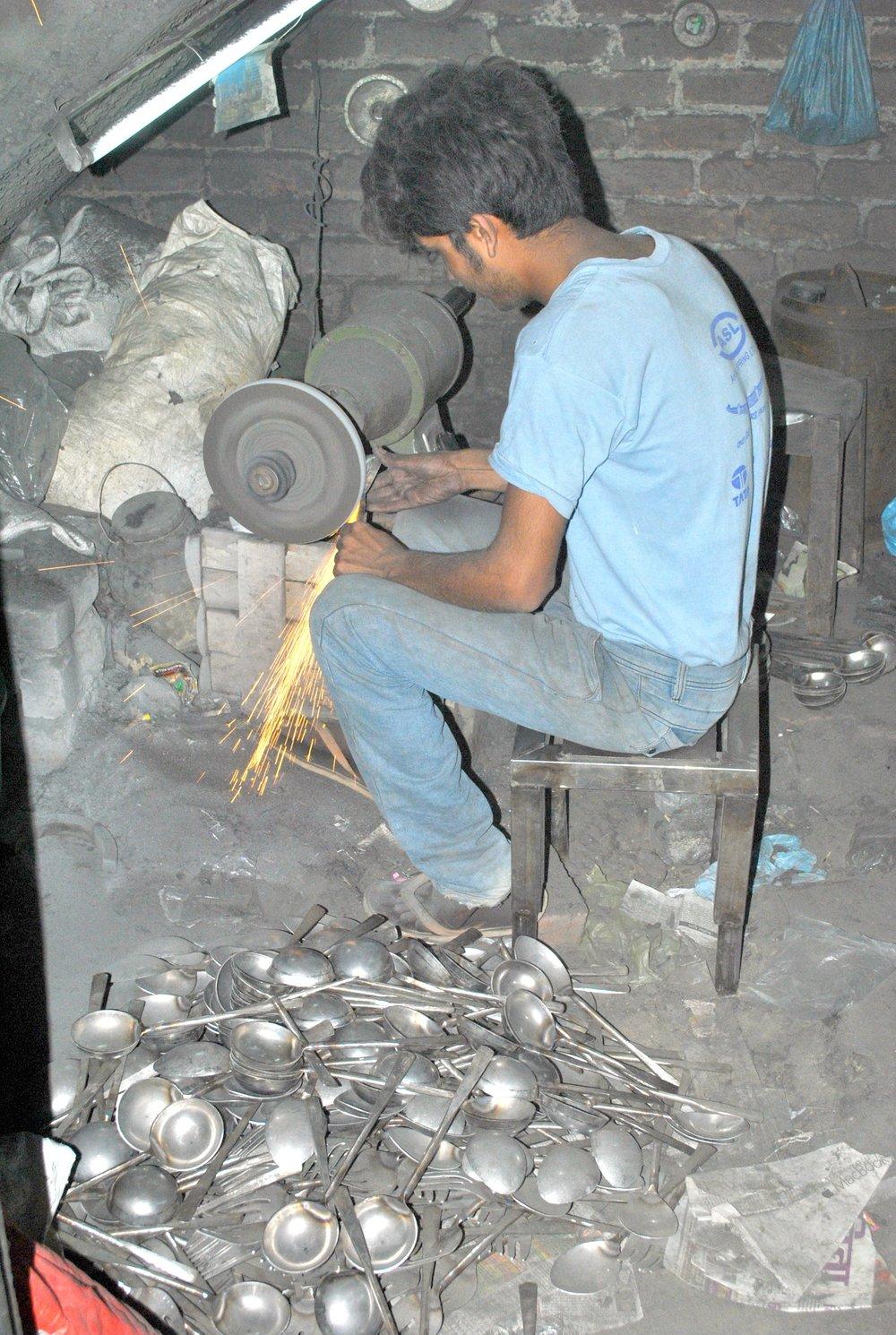 Bablu hand forges ladels for Kazmi Emporium, Moradabad.