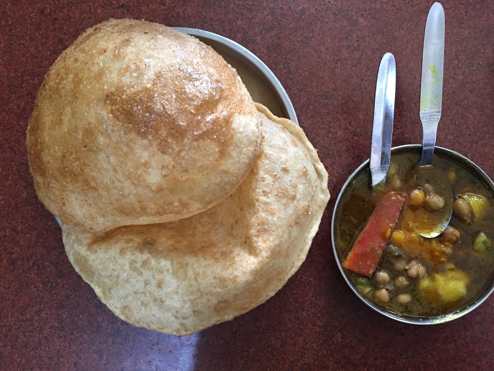 Indian puri with potato curry for breakfast