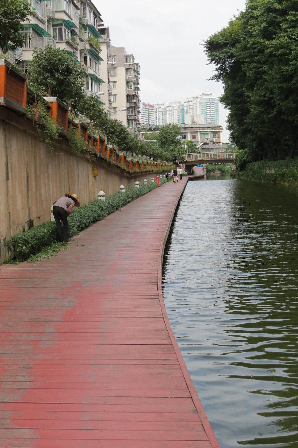A canal path passes under Enning Road in Old Guangzhou