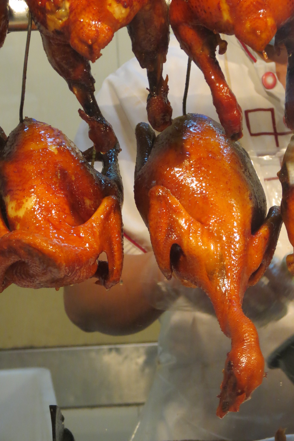 Roasted chickens and ducks in a shop window in Guangzhou's Enning Road Market