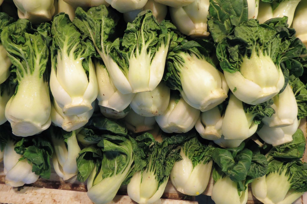 Neatly stacked bok choy in the Guangzhou Enning Road Market