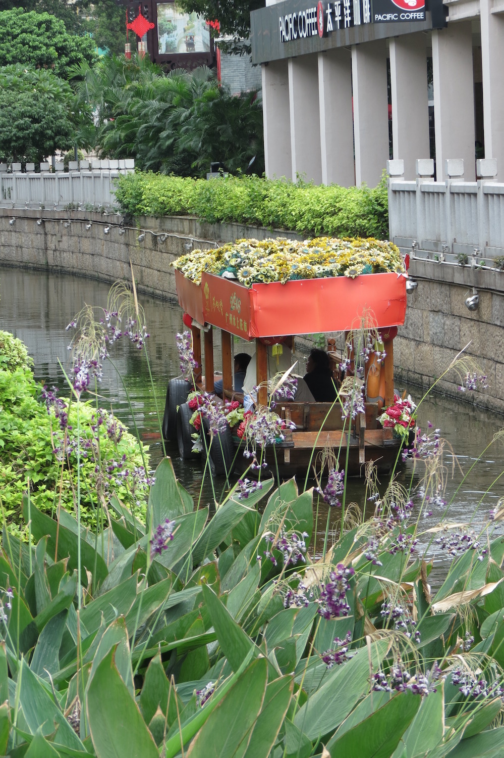 Flower-covered wooden boat in Guangzhou's Liwan Lake Park