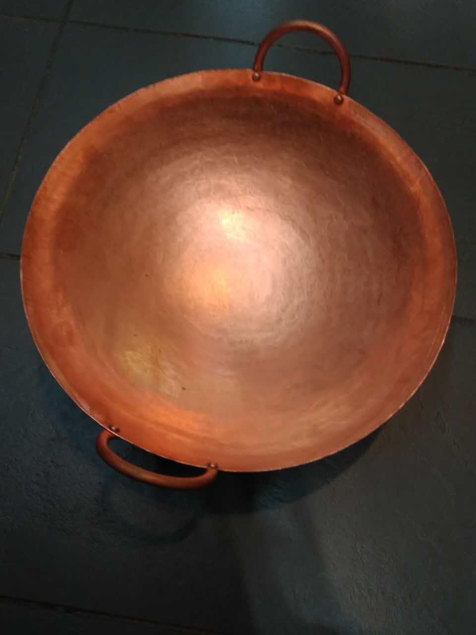 Hand-forged wok from the family-owned Baohui Copper Workshop in Old Guangzhou