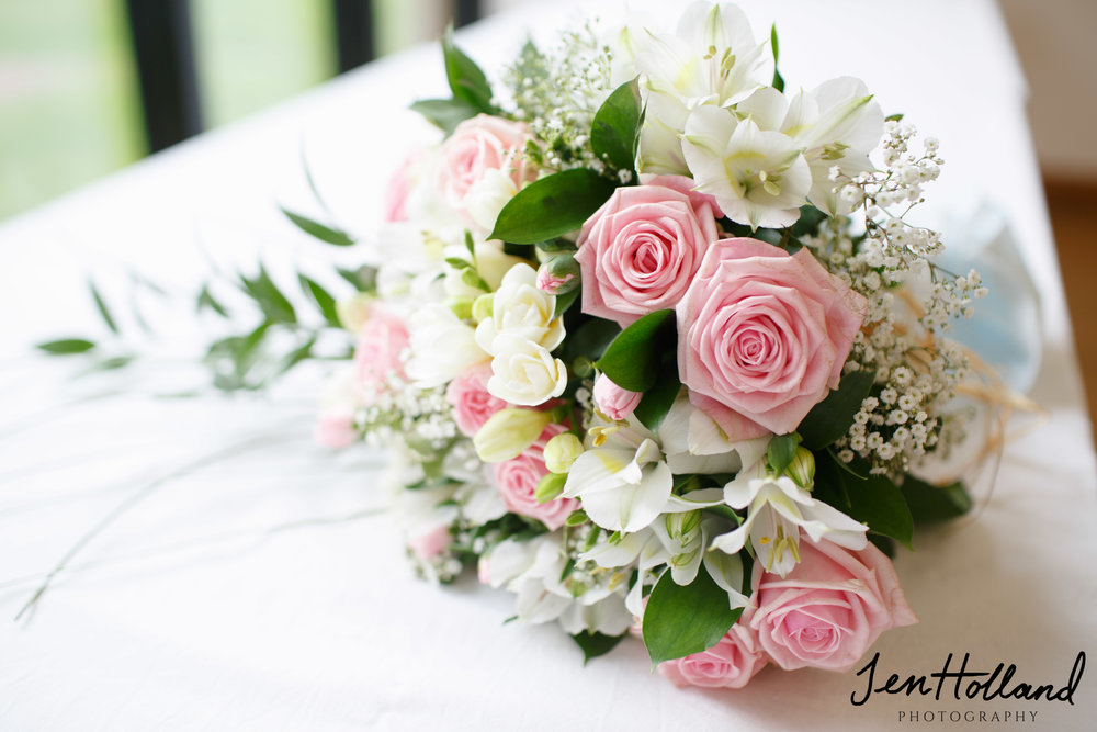 Bride's bouquet: Alstromeria, Roses, Freesias and  Gysophila