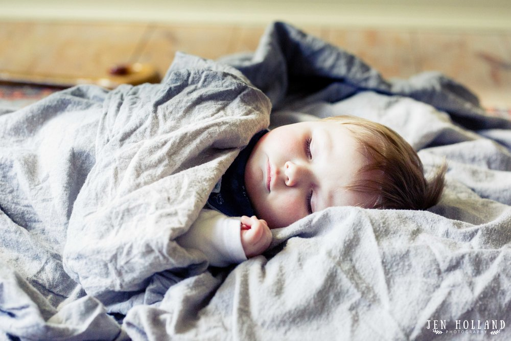 Baby James sleeping soundly in a Jersey sheet