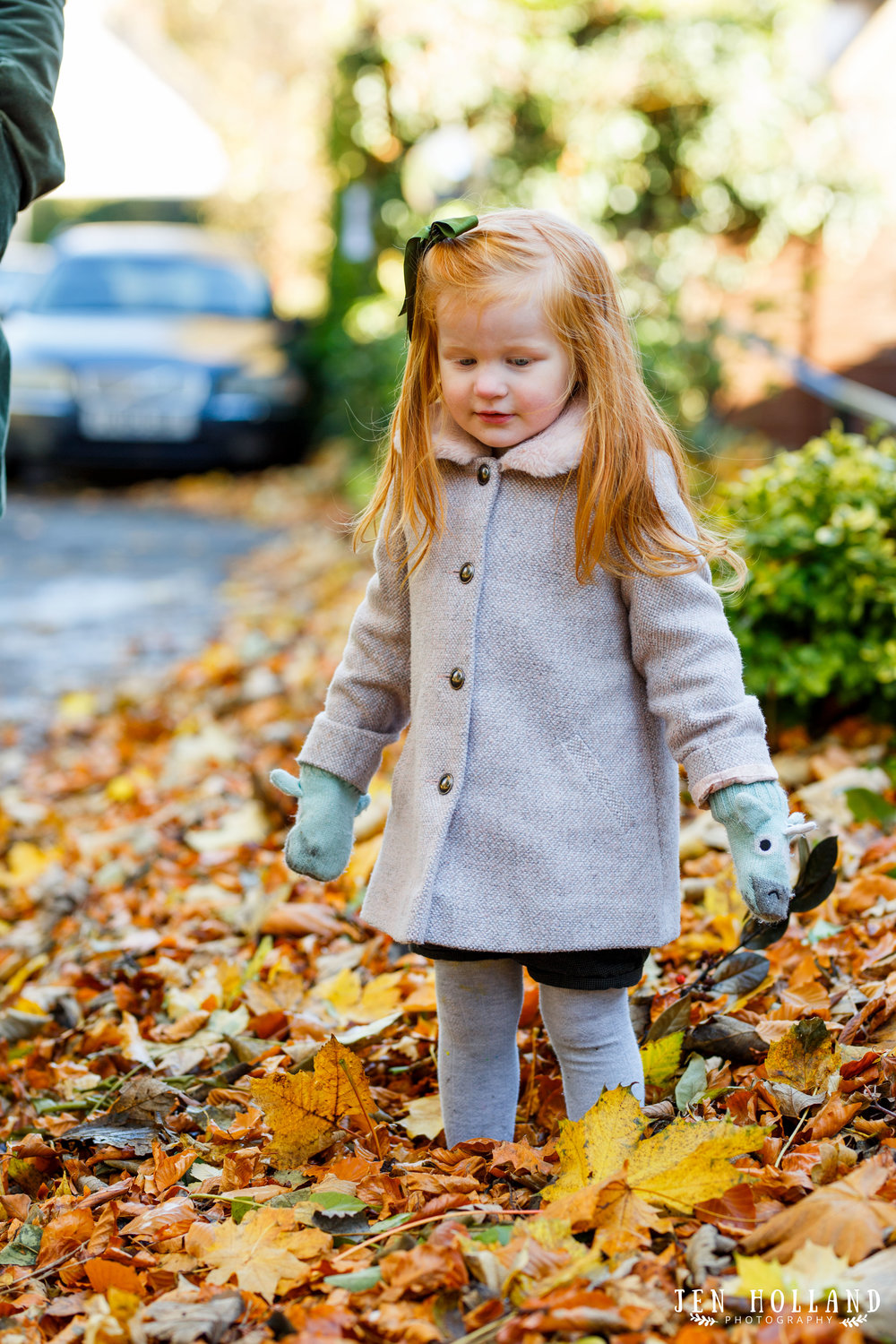 Red haired girl playing in the autumn leaves, Westbere, Kent