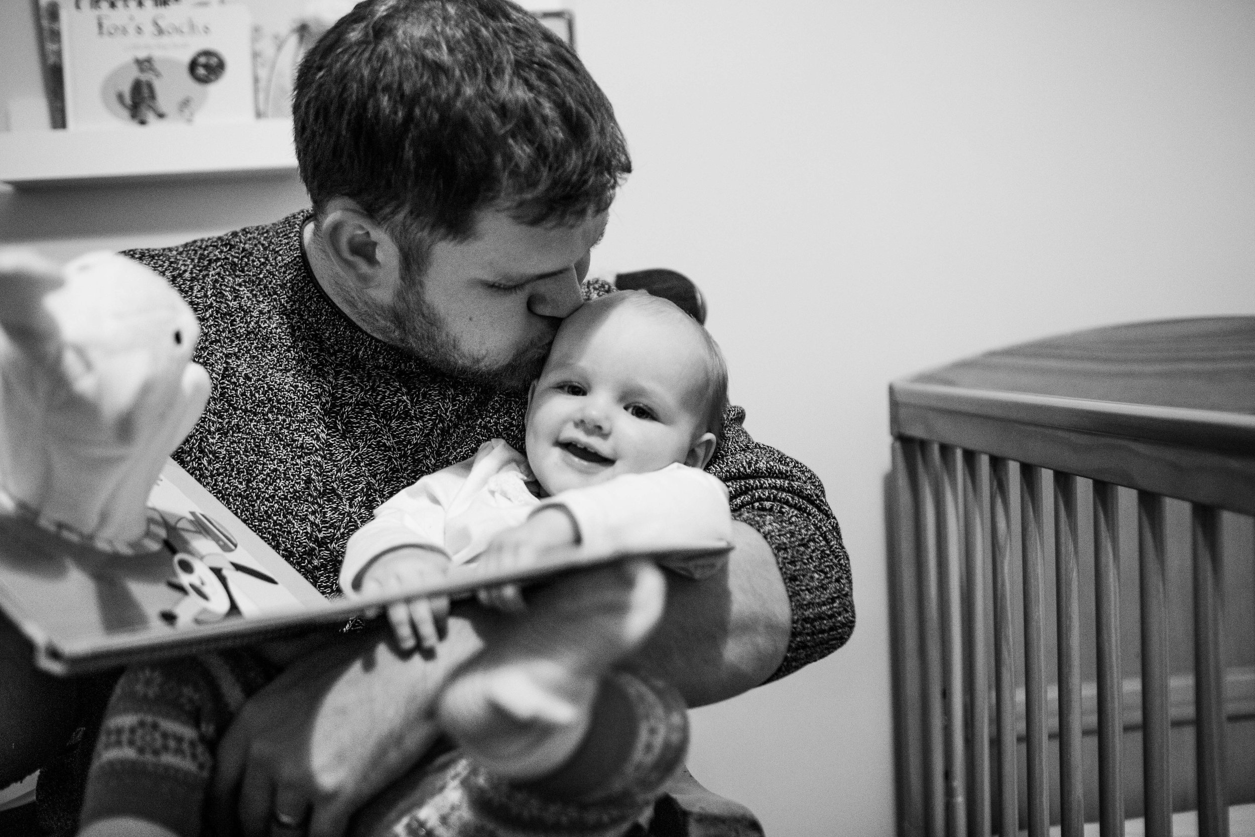 Bedtime reading, with baby, family portraits, uncle and niece, snuggle bunny book