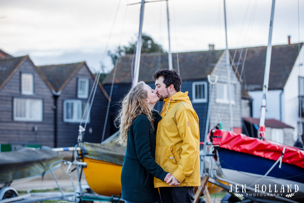Couple engagement shoot, Whitstable Harbour, boats, couple kiss, pre wedding shoot