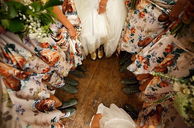 Doin' it the right way - this #bridesquad wore coordinated #docmartens for Amy and Steve's festival inspired wedding! And they were glad of them as it rained almost the whole day. Check out Amy's glittery gold ones! #wed2b #squadgoals #bridecrew #thisisreportage #documentaryweddingphotographer #dwpcollective #wedfest #dirtybootsandmessyhair #festivalwedding #thedreys #kentweddingphotographer #unconventionalwedding #festivalstylewedding #junebugweddings #indiewedding #smokebombs #bohobride #wereengaged #justmarried #mrandmrs #festivalbride #floralbridesmaids #drmartens #drmartensstyle #crushinit #doingitright #bridebookbridesmaids