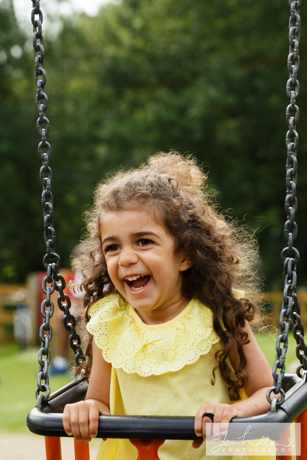 little-girl-on-a-swing-toddlers-cove