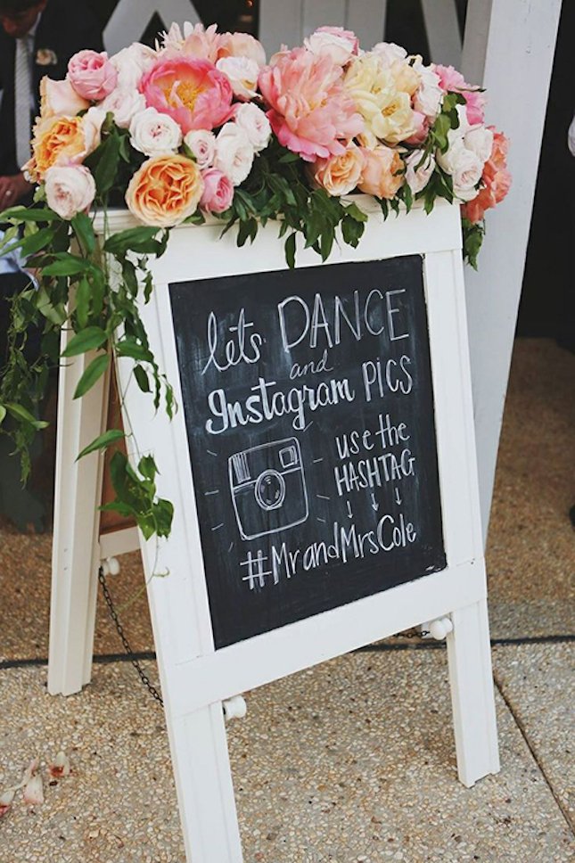 wedding-hashtag-chalkboard-with-flowers1.jpg