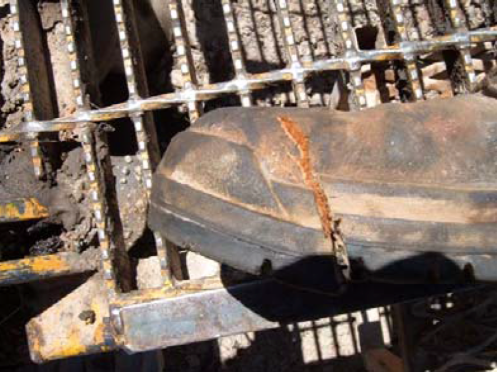 The damaged boot