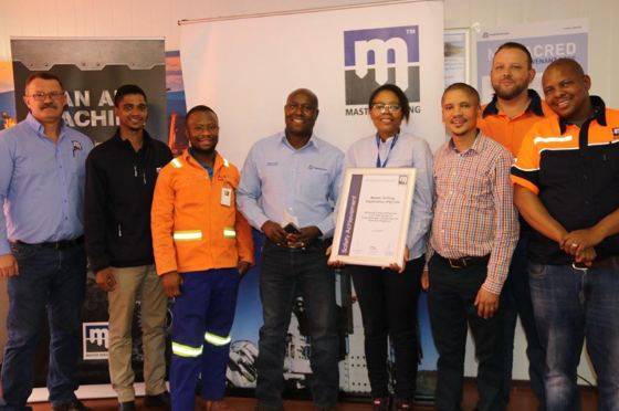 Left to right: Mr. Eddie Dixon (COO -– MDX); Mr. Trevor Booysen (Senior SHERQ – MDX); Mr. Macdonald Modise (Full-time SHE rep – Kolomela); Mr. Masala Mutangwa (GM – Kolomela); Ms. Refilwe Legotlo (Acting MTS – Manager); Mr. Jackie Lourence (Section Manager – SHE Kolomela); Mr. Jasper Coetzee (Operations Manager – MDX) and Mr. Puso Galehole (Safety Officer – MDX).