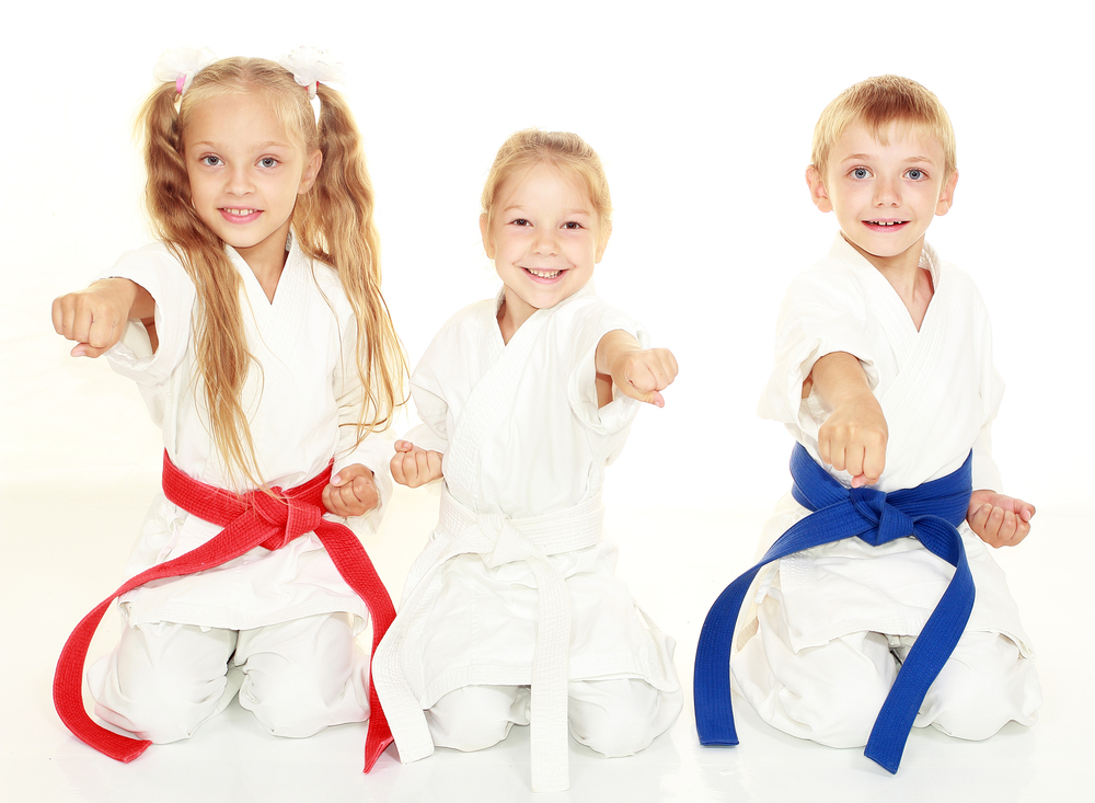 "Karate Kids: The Benefits of Martial Arts Training for Kids By Alison Hendrie With a bloodcurdling cry, your 6-year-old leaps into the air in a karate kick, raising your hair and blood pressure simultaneously. Before you panic and pad the walls, try channeling this urge into a martial arts class. Activities like karate and tae kwon do are a fun way for both boys and girls to achieve fitness and focus. Some parents may think they also promote violence, but that's a myth, according to experts. The martial arts actually help teach self-discipline and socialization skills. In fact, many parents whose children have attention-deficit/hyperactivity disorder (ADHD) report great success with these programs because self-control and concentration are exactly the skills underdeveloped in ADHD kids. A typical hour-long class begins and ends with a bow to the teacher, or master. After a warm-up, students practice the art's particular skills, which may include kicks, punches and blocks. Each requires concentration and strict attention. Progress is often marked by the belt system, which takes the beginner from a white belt through a variety of colors until black. Testing for each new level, generally every three months, is a good exercise in setting and achieving goals. But, say experts, it's the respect kids learn, whether from bowing or standing still and waiting for the next command, that can be the most important benefit: It often carries over into school, helping to improve behavior and even grades, according to recent research. ""Six is usually a good age to start classes,"" says Mimi Johnson, M.D., a member of the American Academy of Pediatrics' Committee on Sports Medicine and Fitness. By that time a child should have enough muscle control to punch and turn properly and safely—essential to getting a real kick out of the martial art he chooses."