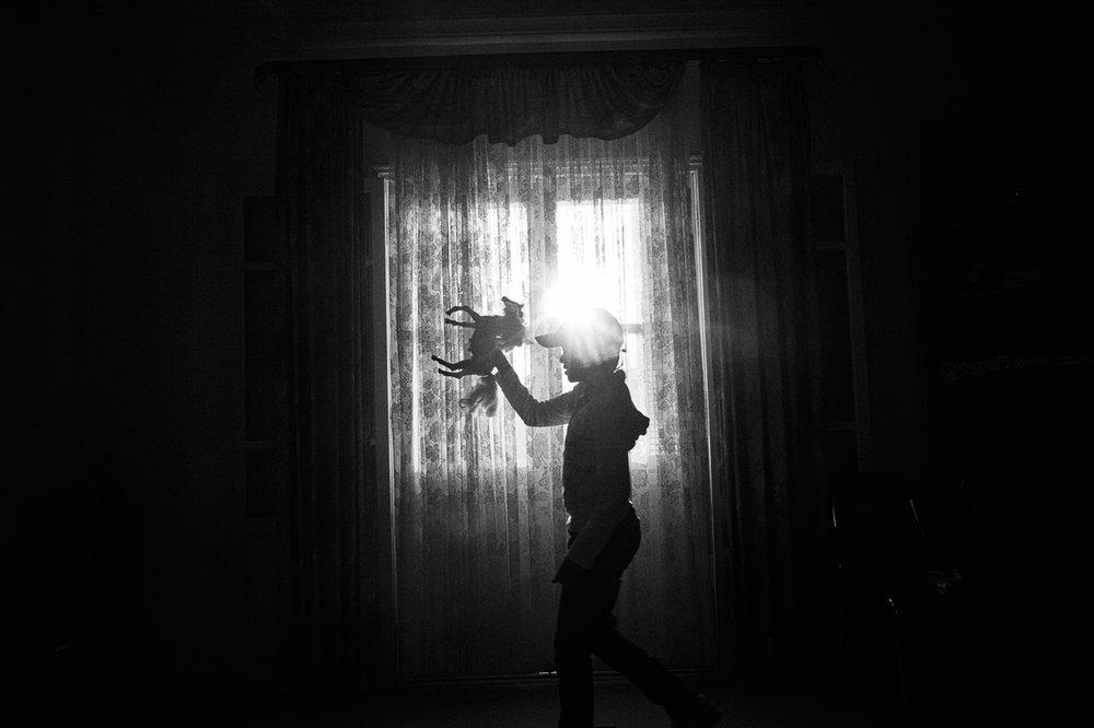 POPCAP_2015_Winner_1280px_RGB_22Amani (10) playing near a window protected by a UV film.jpg