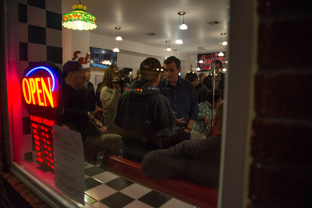 Republican presidential candidate Ted Cruz speaks with a voter during a campaign stop at Greggo's Pizza & Sandwiches in Mount Ayr, Iowa, on Nov. 28, 2015.