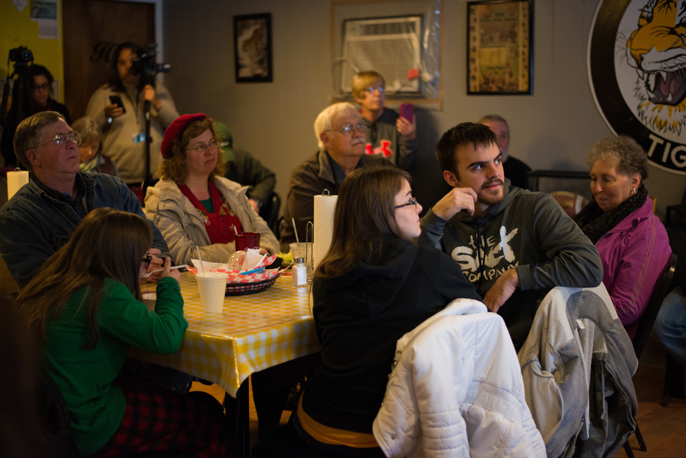 Voters listen to Republican presidential candidate Ted Cruz during a campaign stop at Tiger Den restaurant in Lenox, Iowa, on Nov. 28, 2015.