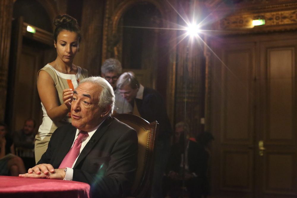 A makeup artist prepares Dominique Strauss-Kahn, the former head of the International Monetary Fund, for an interview with CNN anchorman Richard Quest in Paris on July 9, 2013.