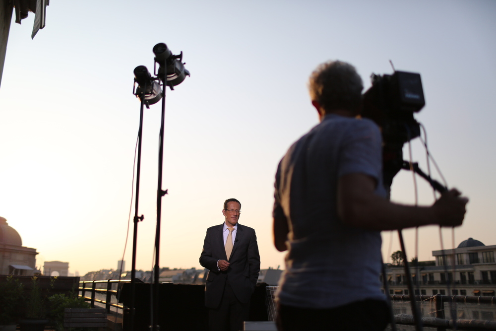 CNN's Richard Quest anchors his show Quest Means Business from a balcony overlooking the Champs-Elysées avenue in Paris on July 9, 2013.