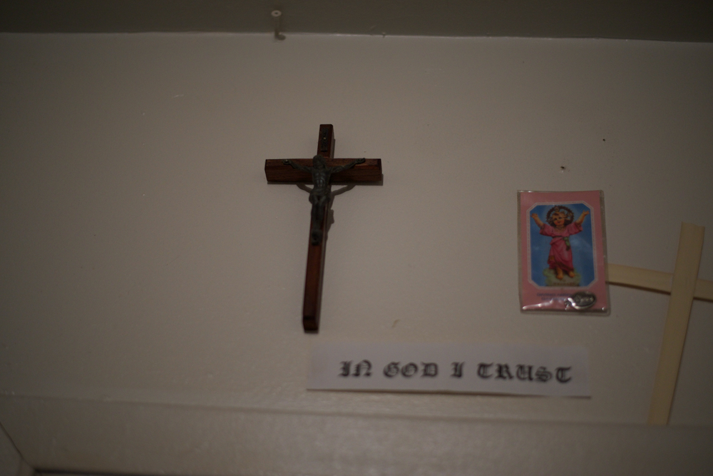 A cross of Jesus Christ hangs above the doorway in Denis Reyes' bedroom. Reyes' mother, Blanca Sierra, said her son was increasingly spiritual.