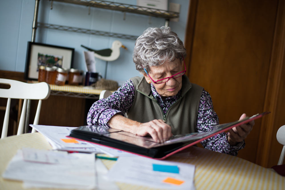 Evelyn Marconi, who founded Geno's Chowder & Sandwich Shop with her husband in 1965 in Portsmouth, New Hampshire, takes a look on Jan. 30, 2016, at a scrapbook of photographs of famous politicians who have made campaign stops at the restaurant.
