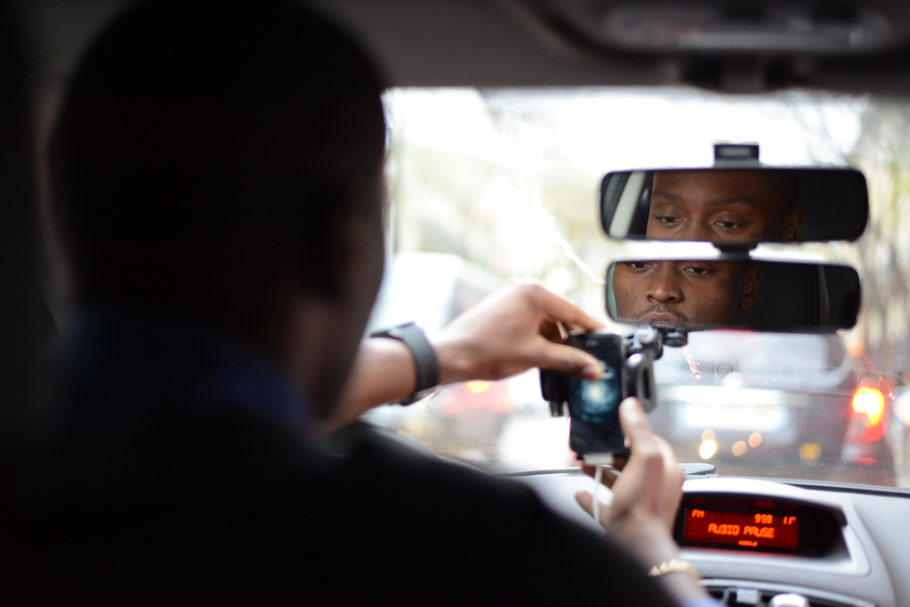 Anthony Loussala-Dubreas, a French UberPOP driver, turns on his smartphone in his car in Paris on Dec. 14, 2014.