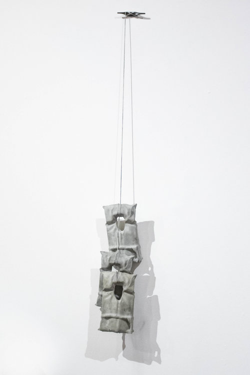 "hang in there , 2018, 36""x8""x4""  boat cleat, nylon rope, cast concrete"