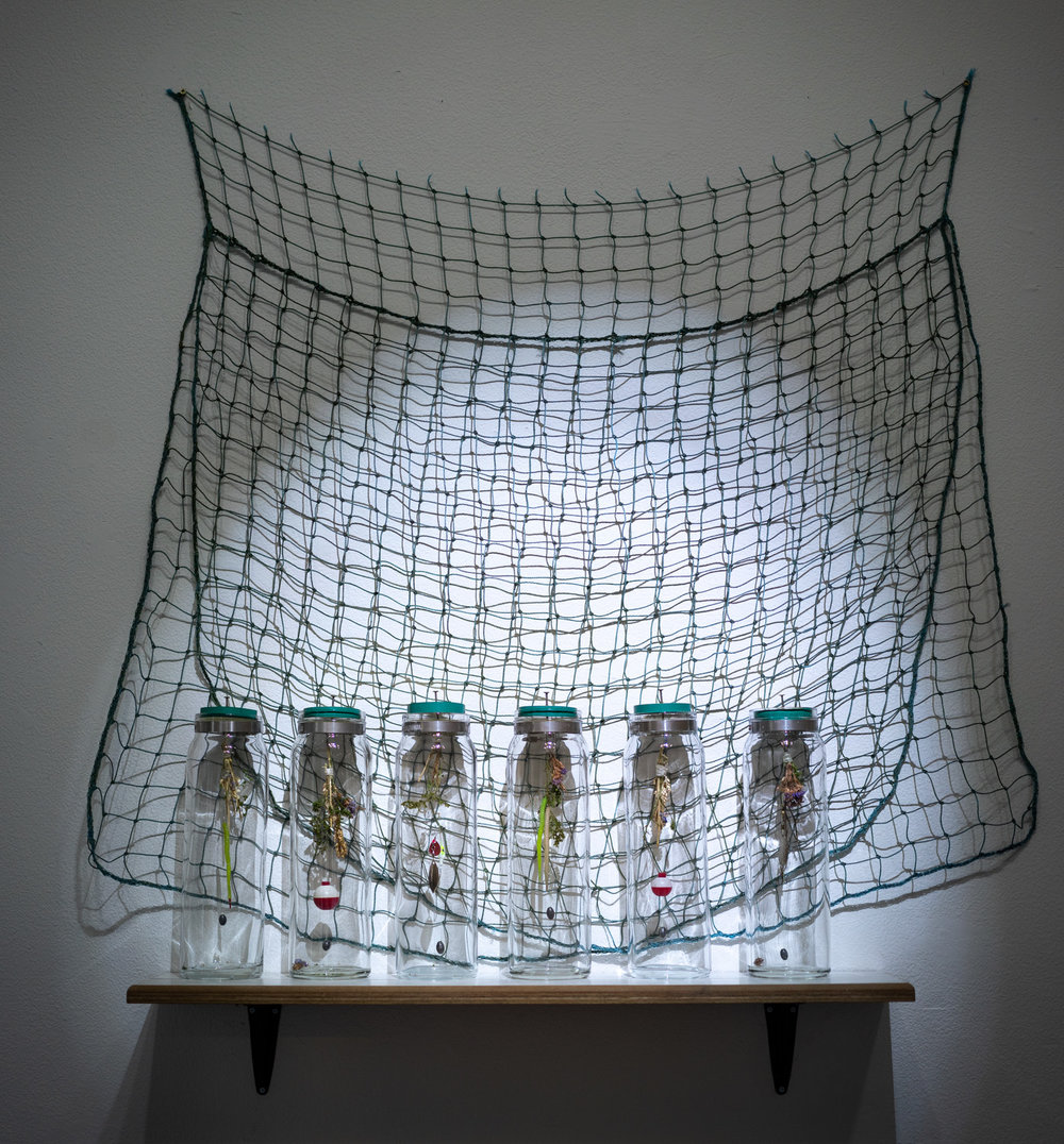 hook, line, and sink her, 2018  glass jars, netting, laminate flooring, bobbers, sinkers, hooks, dried flowers, electrical tape, notebook paper, cork, nails, string