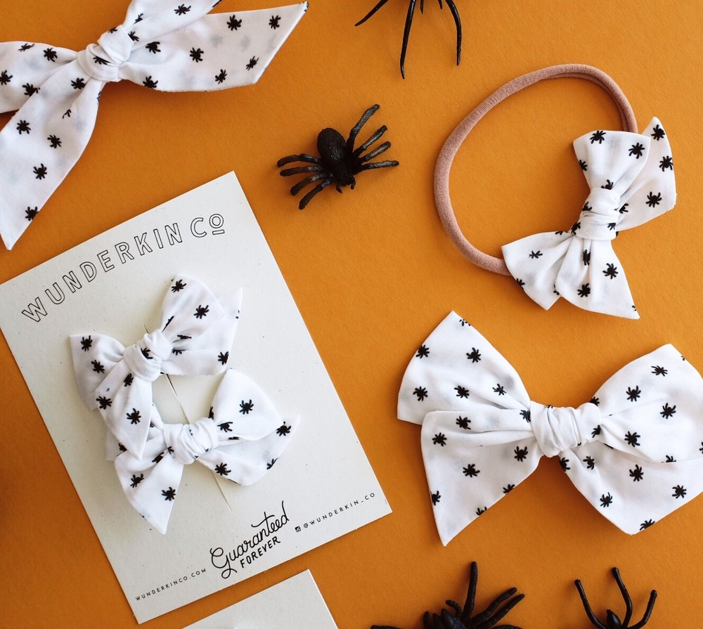 We've never been ashamed of our love for celebrating all holidays to the extreme, so when Hillary, from Wunderkin Co. approached us about doing an exclusive Halloween pattern for their hand-crafted, heirloom bows, the answer was obvious! Introducing the first @ampersandstudio x @wunderkin_co print - a ditsy spider that is somehow oh so cute, but just perfectly creepy at the same time! What do you guys think?
