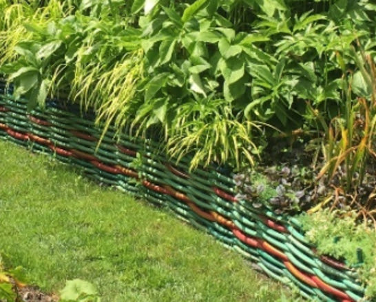 Tired of stone retaining walls? How about a wall of woven hoses. Hold onto those broken leftovers.