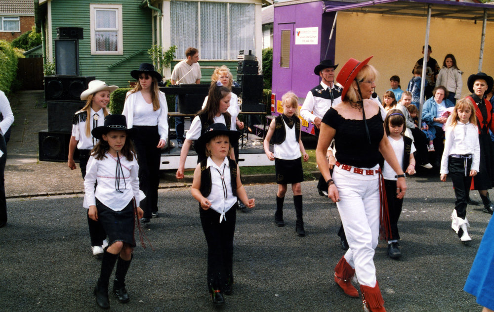 Line Dancing at an Austin Village street party, c. 1992