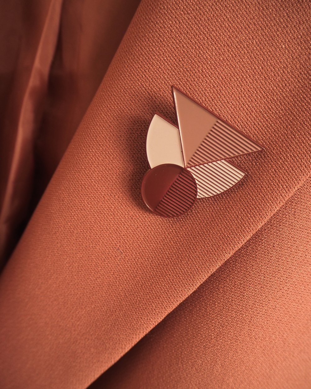 Geometric brooches