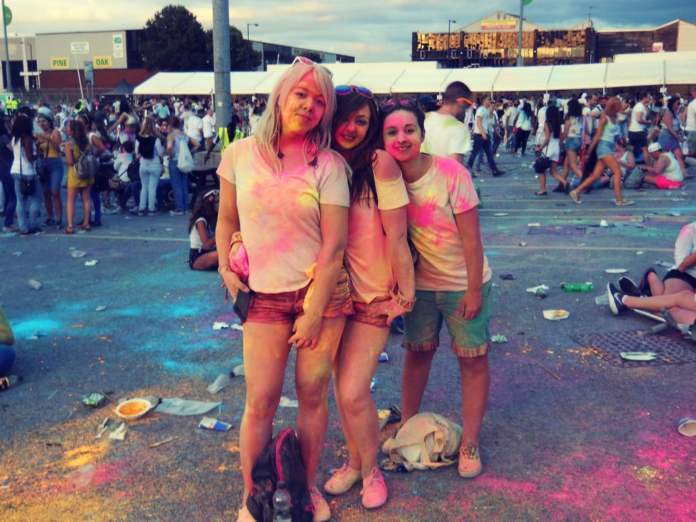 Nearing the end of the festival, orangified festival-goers posing for a photo in the middle of accumulating rubbish
