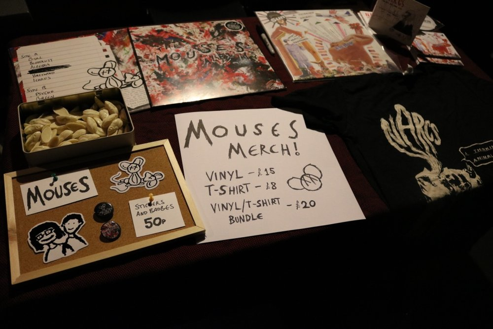 Temptingly funky merch: white chocolate mice, badges, vinyls, t-shirts ...