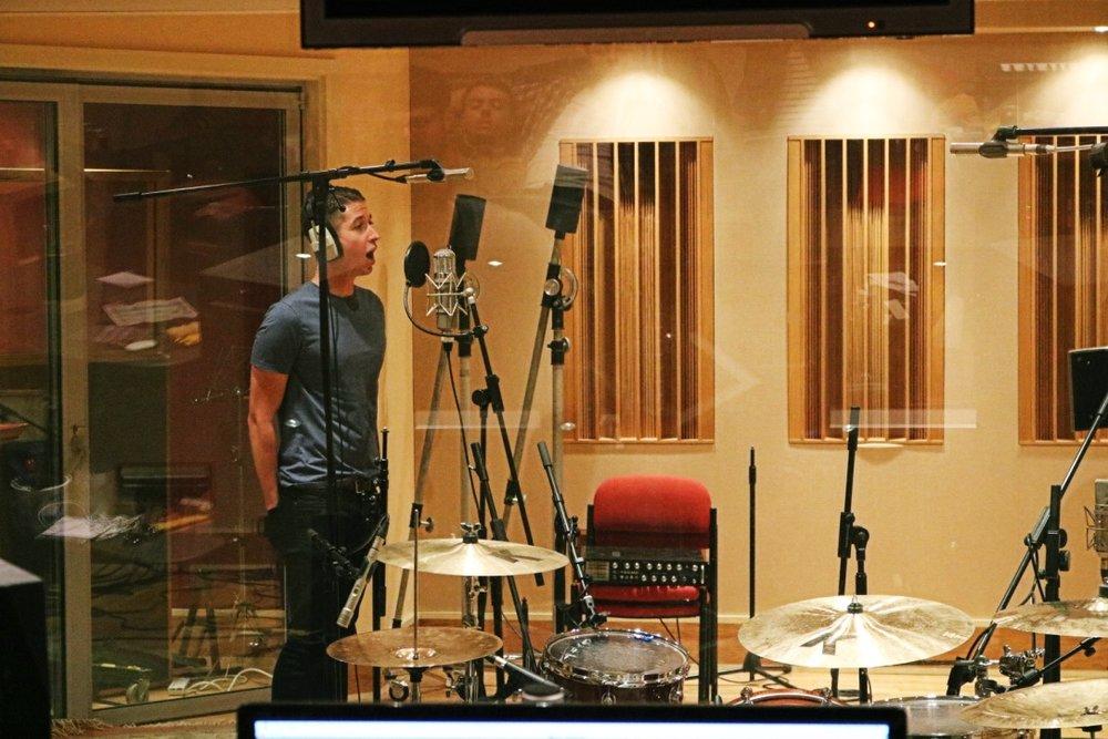 Liam Rowden recording the vocals