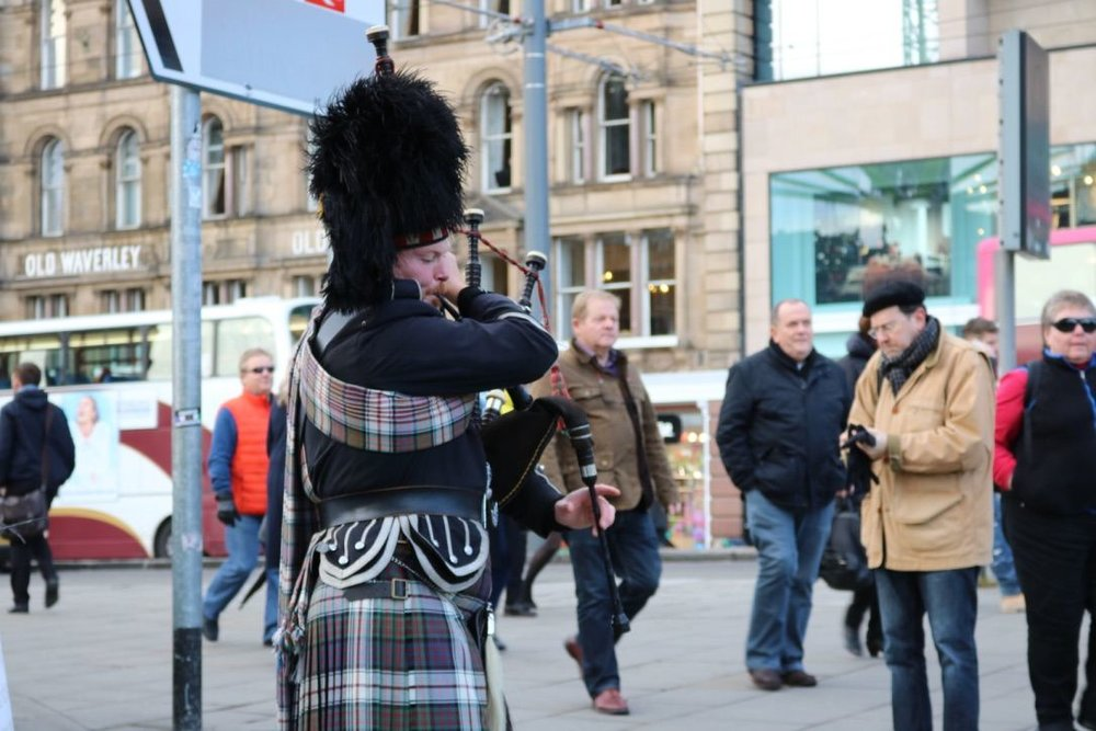 The city's token bagpiper entertaining passers-by
