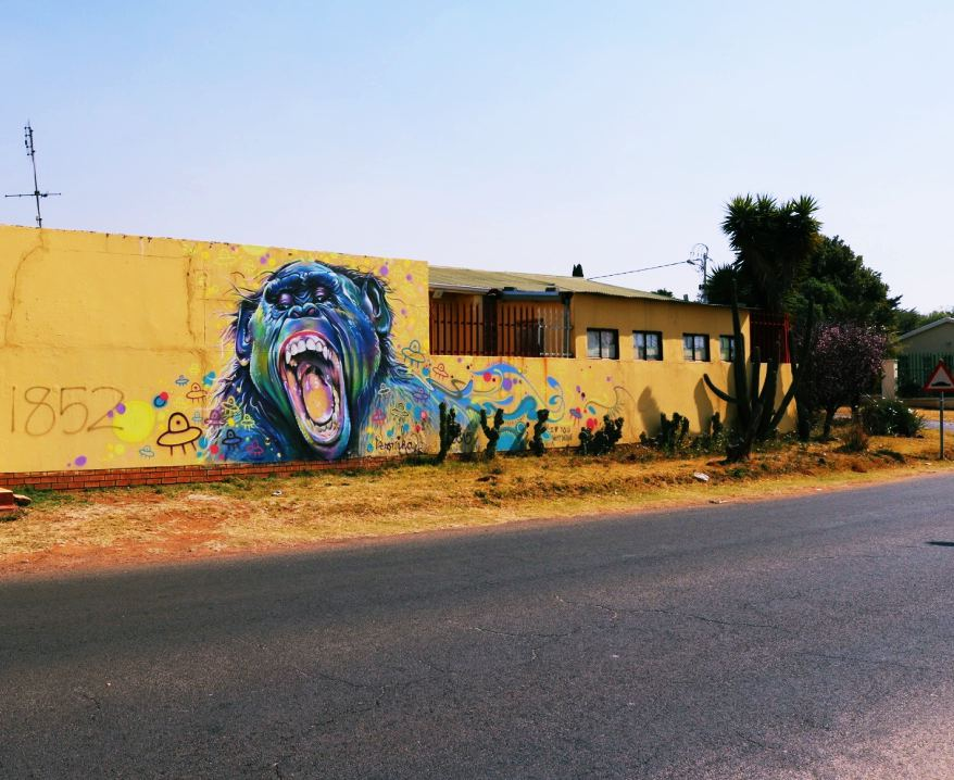 A literal layer of vibrancy: BenJay Crossman's Tekno Bonobo mural on the corner of 2nd Avenue and Monmouth Road