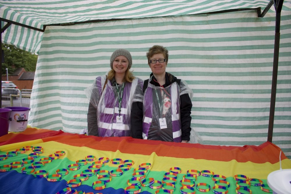 Fellow volunteers manning the Durham Pride UK stall