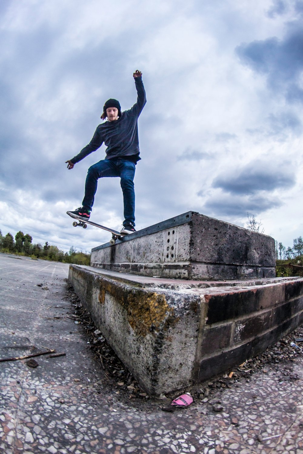 Photo taken by Ryan Welsh of Paul Spurs performing a krooked grind on the ledge in a DIY skatepark in Washington.