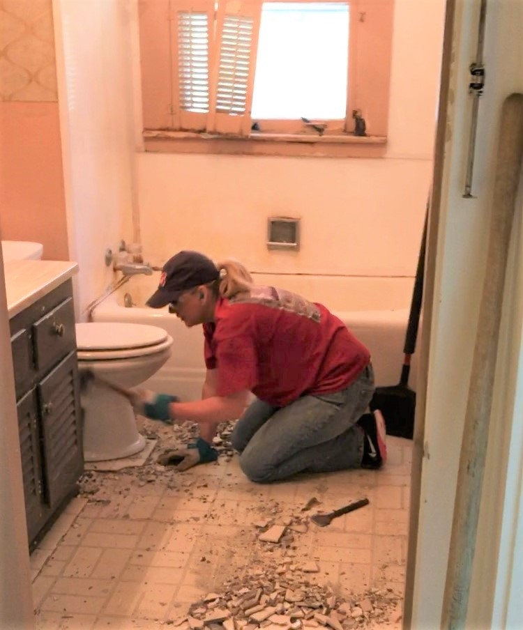 Braxton's stepmom busting up tile in the bathroom - impressive!